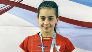 Az úszás aranyérmes Lilije